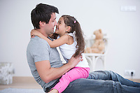 Side view of father and daughter spending quality time at home