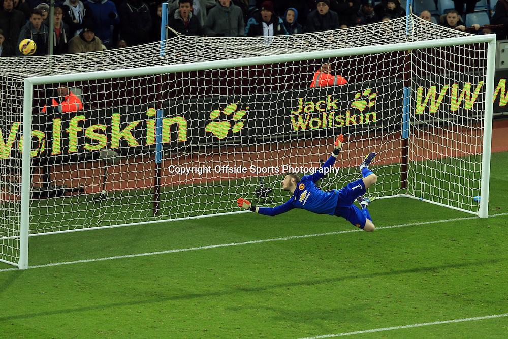 20 December 2014 - Barclays Premier League - Aston Villa v Manchester United - Manchester United goalkeeper, David de Gea looks on as the ball flies over the crossbar - Photo: Marc Atkins / Offside.
