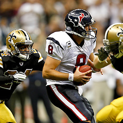 September 25, 2011; New Orleans, LA, USA; New Orleans Saints cornerback Leigh Torrence (24) sacks Houston Texans quarterback Matt Schaub (8) during the fourth quarter at the Louisiana Superdome. The Saints defeated the Texans 40-33. Mandatory Credit: Derick E. Hingle