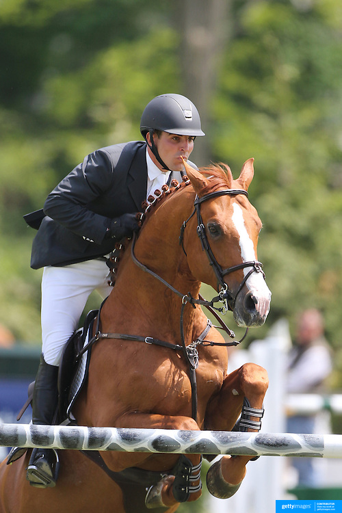 Michael Desiderio riding Temptation in action during the $35,000 Grand Prix of North Salem presented by Karina Brez Jewelry during the Old Salem Farm Spring Horse Show, North Salem, New York, USA. 15th May 2015. Photo Tim Clayton
