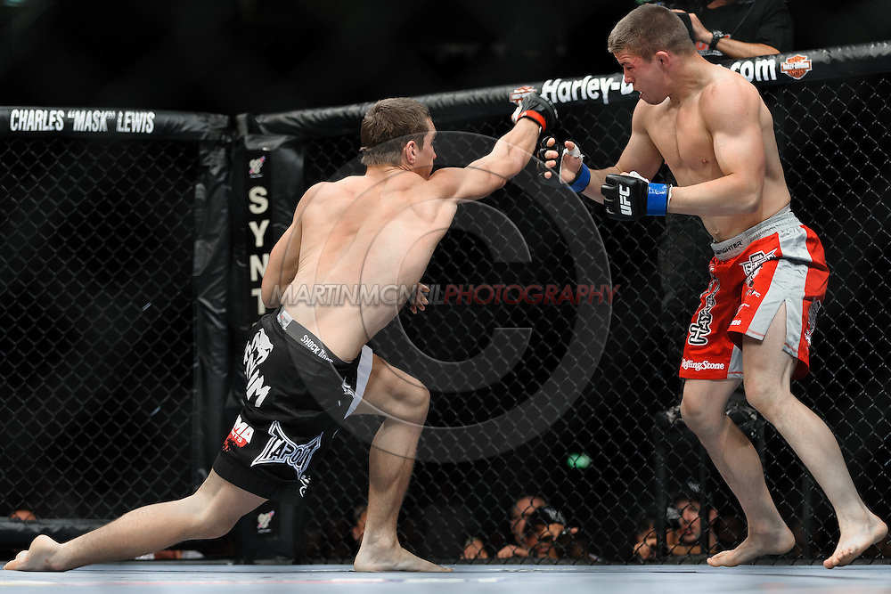 "COLOGNE, GERMANY, JUNE 13, 2009: John Hathaway and Rick Story during ""UFC 99: The Comeback"" inside LanXess Arena, Cologne"