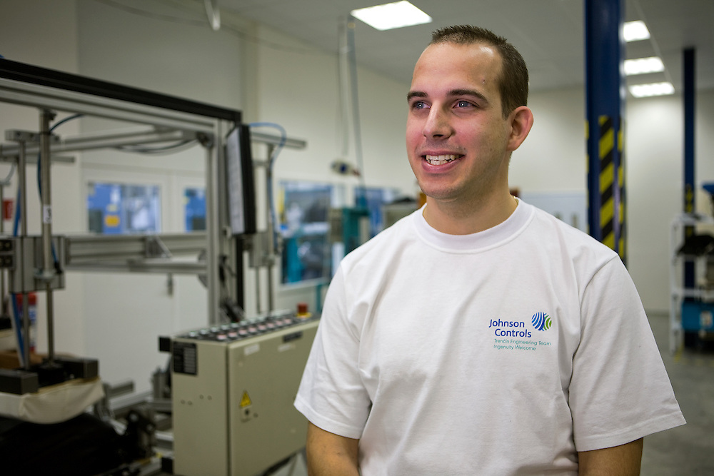 A male employee at a Trencin, Slovakia facility takes a moment out of his day to pose for a portrait.