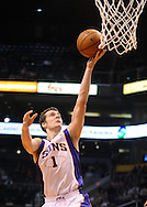 Dec. 17, 2012; Phoenix, AZ, USA; Phoenix Suns guard Goran Dragic (1) lays up the ball during the game against the Sacramento Kings in the second half at US Airways Center. The Suns defeated the Kings 101-90.  Mandatory Credit: Jennifer Stewart-USA TODAY Sports