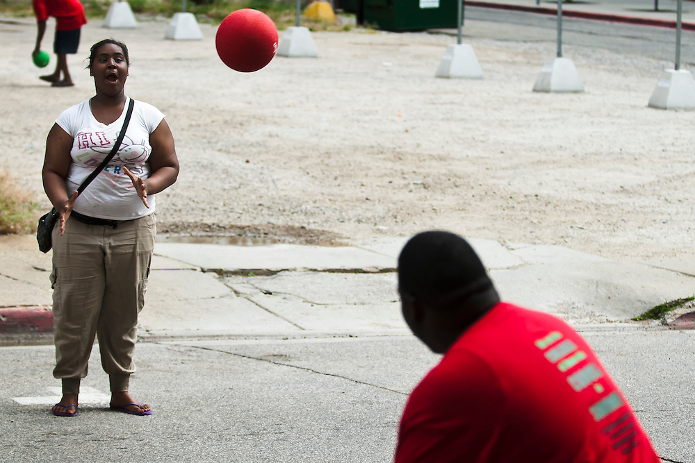 Lathan Goumas | MLive.com..Jah'Reia Ross, 15, of Flint, reacts as she is hit in the face with a ball during a game of dodgeball on Kearsley Avenue as part of the Juneteenth Celebration in downtown Flint on Sunday. About a dozen people gathered on Kearsley Avenue between Saginaw Street and Buckingham Alley to participate in the event.