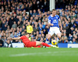 Liverpool's Steven Gerrard tackles Everton's James McCarthy - Photo mandatory by-line: Dougie Allward/JMP - Tel: Mobile: 07966 386802 23/11/2013 - SPORT - Football - Liverpool - Merseyside derby - Goodison Park - Everton v Liverpool - Barclays Premier League