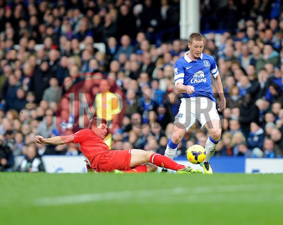 Liverpool's Steven Gerrard tackles Everton's James McCarthy - Photo mandatory by-line: Dougie Allward/JMP - Tel: Mobile: 07966 386802 23/11/2013 - SPORT - Football - Liverpool - Merseyside derby - Goodison Park - Everton v Liverpool - Barclays Premier League