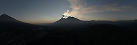 Aerial panorama of Fuego volcano blowing clouds of ash at sunset on Jan. 22, 2019 near Ciudad Vieja, Guatemala. To the right of Fuego is the dormant Acatenango volcano and to the left is the dormant Agua volcano.