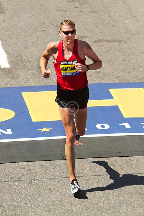 Jason Hartmann crosses in 4th place, top American