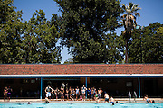 Children swim at Clunie Pool in Sacramento, Calif. on July 1, 2011. Budget cuts have closed many of Sacramento's public pools.