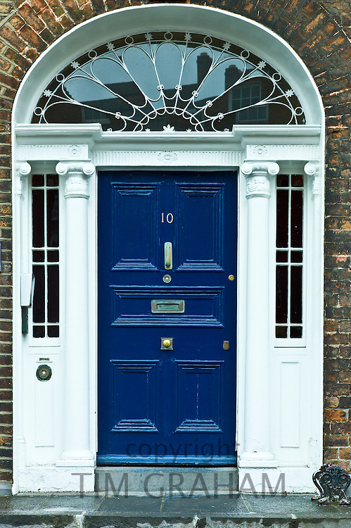 Stylish front door of Georgian townhouse with fanlight window in Limerick City, County Limerick, Ireland