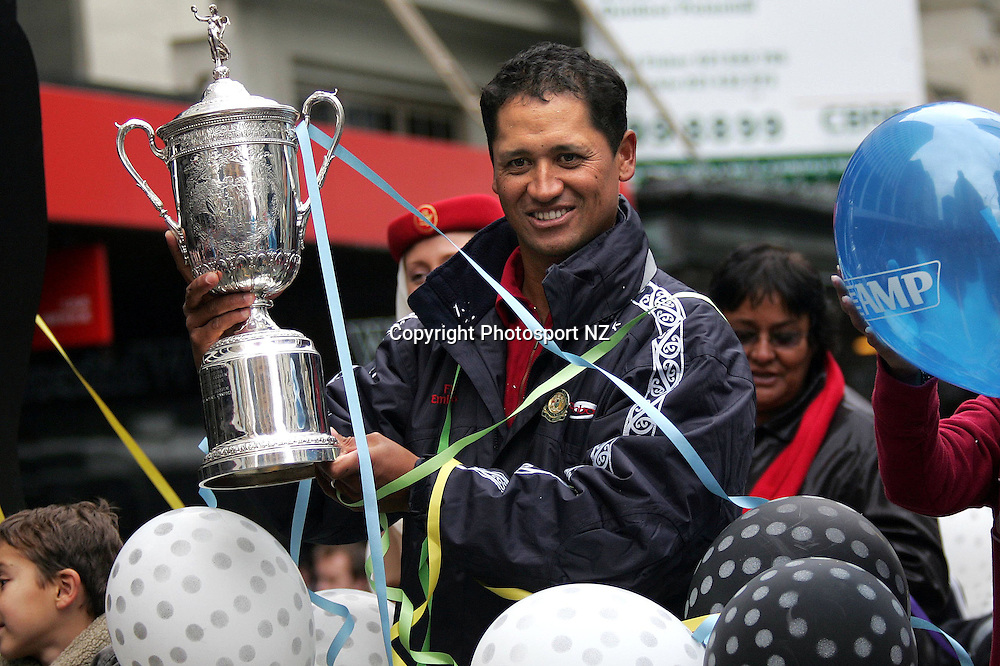 US Golf Open champ Michael Campbell holds the US Open trophy during the parade in his honour moving down Lambton Quay in Wellington on Friday.<br /> Photo: Marty Melville/PHOTOSPORT