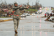 May 23, 2011- A Missouri National Guard member directs traffic in the intersection of East 20th Street and Ridge Lane Road in Joplin, Missouri after a Tornado came through the town on Sunday, May 22, 2011. Credit: David Welker / TurfImages.com.