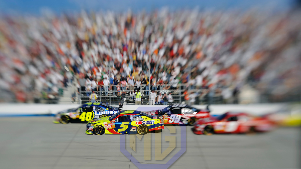21 September 2008:   Jimmie Johnson driving a Chevrolet (48) leads Casey Mears in the Kellogg's/CARQUEST Chevrolet (5), Chase Cup co-leader Carl Edwards in the Office Depot Ford (99) and Kasey Kahne in the Budweiser Dodge (9) in the Camping World RV 400 at Dover International Speedway in Dover, Delaware. The race was won by Greg Biffle who took the lead from teammate Matt Kenseth with 9 laps remaining to win his second Chase Cup race in a row.