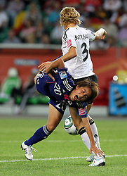 09.07.2011, Arena im Allerpark Wolfsburg , Wolfsburg ,  GER, FIFA Women Worldcup 2011, Viertelfinale ,   Germany (GER) vs Japan (JPN. im Bild Saskia Bartusiak (GER) gegen Mana Iwabuchi (JPN)   //  during the FIFA Women Worldcup 2011, Quarterfinal, Germany vs Japan  on 2011/07/09, Arena im Allerpark , Wolfsburg, Germany.  .EXPA Pictures © 2011, PhotoCredit: EXPA/ nph/  Hessland       ****** out of GER / CRO  / BEL ******
