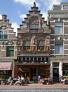 People sitting outdoors cafe tables Visstraat, Dordrecht, Netherlands