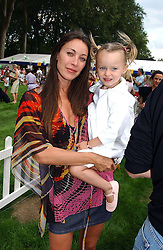 TAMARA MELLON and her daughter MINTY MELLON at the Macmillan Cancer Relief Dog Day held at the Royal Hospital Chelsea South Grounds, London on 6th July 2004.