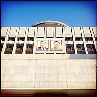 Pictures of Kim Il-sung and Kim Jong-il adorn a building in downtown Pyongyang, North Korea.