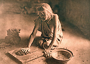 NATIVE AMERICANS Edward Curtis photograph,from the early 20th  century, called The Potter Mixing Clay (Hopi)  tribe in New Mexico