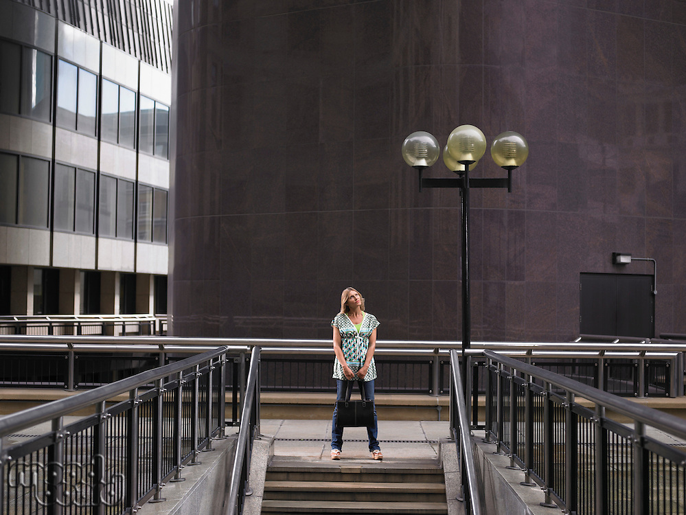 Woman standing at top of steps