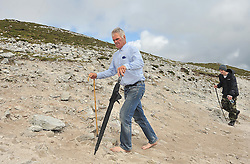 Taking the two stick approach....Camillus Glennon from Ballinalack Co Westmeath pictured on his way to the summit of Croagh Patrick yesterday.<br /> Pic Conor McKeown