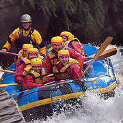 Rafters navigate a rapid on the Shotover River in Queenstown. Challenge Rafting operates a variety of exciting half day trips on the Shotover and Kawarau Rivers.white water rafting in Queenstown, South Island, New Zealand. 23rd March 2011. Photo Tim Clayton.