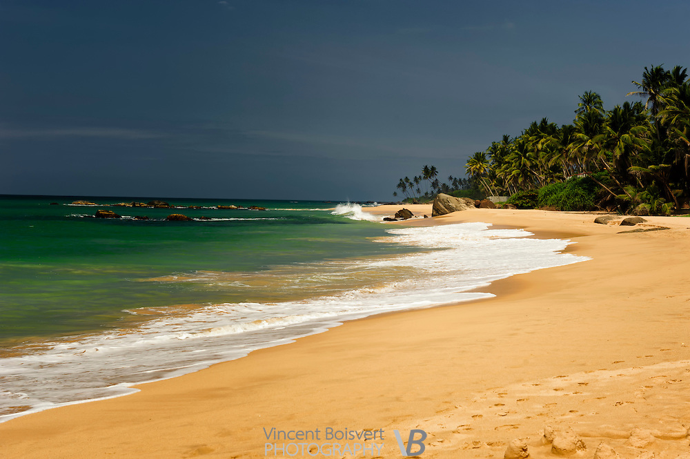 a tranquile tropical beach on the south-western shore of sri lanka