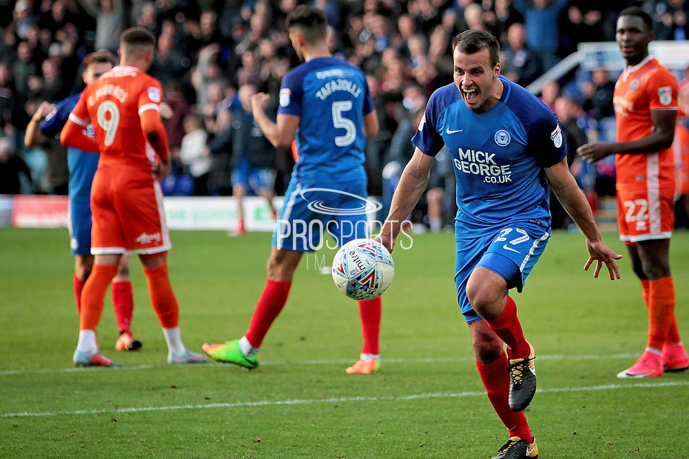 Peterborough United defender Steven Taylor (27) celebrates after the final whistle in the EFL Sky Bet League 1 match between Peterborough United and Shrewsbury Town at London Road, Peterborough, England on 28 October 2017. Photo by Nigel Cole.
