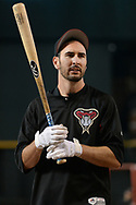 PHOENIX, AZ - AUGUST 10:  Adam Rosales #9 of the Arizona Diamondbacks warms up during batting practice for the MLB game against the Los Angeles Dodgers at Chase Field on August 10, 2017 in Phoenix, Arizona.  (Photo by Jennifer Stewart/Getty Images)