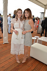 Left to right, sisters HANNAH TOINTON and KARA TOINTON at the Audi Polo Challenge at Coworth Park, Blacknest Road, Ascot, Berkshire on 31st May 2015.