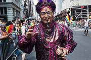 New York, NY - 30 June 2019. The New York City Heritage of Pride March filled Fifth Avenue for hours with participants from the LGBTQ community and it's supporters. A man dressed as Aladdin with his magic lamp was one of many costumed participants.