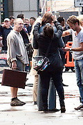 04.AUGUST.2012. LONDON<br /> <br /> BRAD PITT HAVING HIS PONY TAIL FIXED BACK ON, ON THE SET OF THE COUNSELOR WITH A STUNT DOUBLE CURRENTLY BEING FILMED IN EAST LONDON.<br /> <br /> BYLINE: EDBIMAGEARCHIVE.CO.UK<br /> <br /> *THIS IMAGE IS STRICTLY FOR UK NEWSPAPERS AND MAGAZINES ONLY*<br /> *FOR WORLD WIDE SALES AND WEB USE PLEASE CONTACT EDBIMAGEARCHIVE - 0208 954 5968*