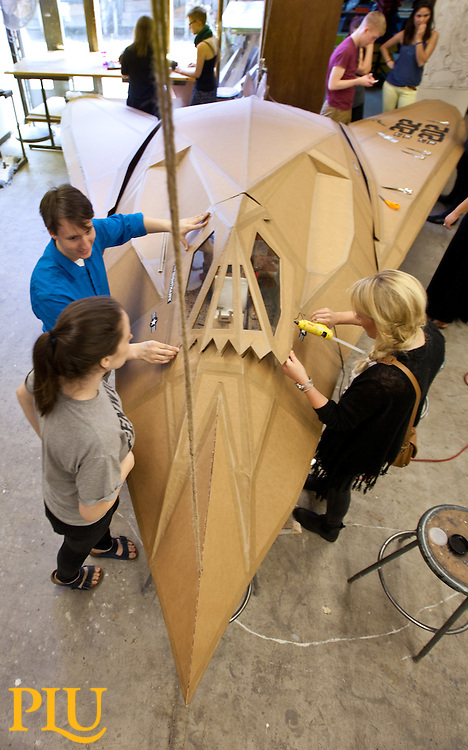 Students in Spencer Ebbinga's 3D modeling class working on an F-117 Stelth sculpture make out of cardboard at PLU on Tuesday, April 1, 2014. (Photo/John Froschauer)
