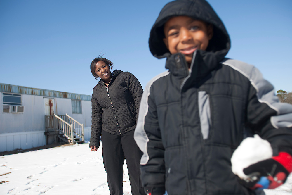 Latonia Best and her five-year-old son, Justin Cobb, play in the snow outside their home near La Grange, N.C., on Sunday, Feb. 14, 2010. Justin recently had a bad earache and recovered without the aid of antibiotics, as advised by a doctor. ..D.L. Anderson for The Wall Street Journal.EAR
