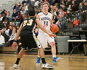Webster Schroeder's Brandan Gartland is defended by Greece Athena's Zac DiSalvo during a game at Webster Schroeder High School on Friday, January 23, 2015.
