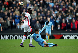 Milton Keynes Dons' Ousseynou Cisse and Coventry City's Maine Biamou battle for the ball during the Emirates FA Cup  Fourth Round match at  Stadium MK Milton Keynes.