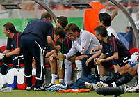 Photo: Glyn Thomas.<br />England v Ecuador. 2nd Round, FIFA World Cup 2006. 25/06/2006.<br /> England's David Beckham (C) is given a tablet on the bench after being substituted.