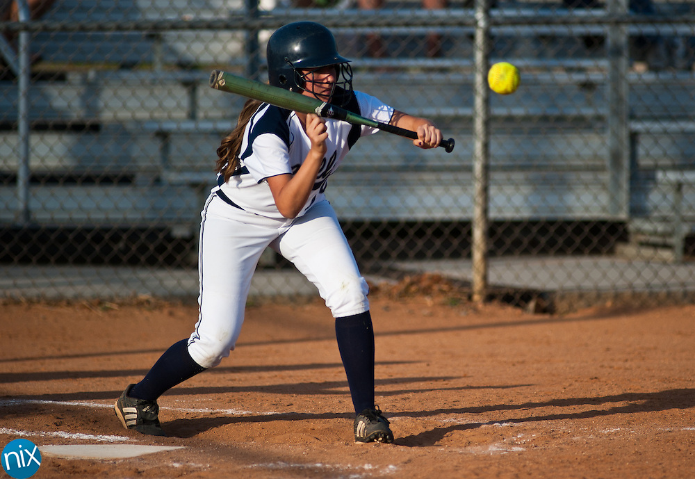 Hickory Ridge's Sarah Behling looks to bunt against Concord in South Piedmont Conference softball action Tuesday afternoon in Harrisburg. Hickory Ridge won the game 7-1.  (Photo by James Nix)