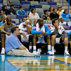 January 29, 2012; New Orleans, LA, USA; New Orleans Hornets point guard Jarrett Jack (2), power forward Carl Landry (24), shooting guard Xavier Henry (4), center Emeka Okafor (50), shooting guard Marco Belinelli (8) and power forward Jason Smith (14) watch from the bench during the fourth quarter of a game against the Atlanta Hawks at the New Orleans Arena. The Hawks defeated the Hornets 94-72.  Mandatory Credit: Derick E. Hingle-US PRESSWIRE