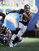 SAN DIEGO - JANUARY 14:  Running back Michael Turner #33 of the San Diego Chargers runs for a key first down against the New England Patriots at the AFC Divisional Playoff Game held on January 14, 2007 at Qualcomm Stadium in San Diego, California. The Patriots defeated the Chargers 24-21. ©Paul Anthony Spinelli *** Local Caption *** Michael Turner