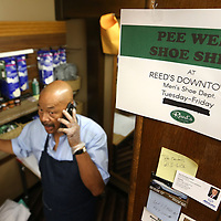 Pee Wee talks with a friend on the phone during a break at his work station at Reed's in downtown Tupelo.