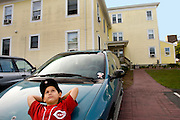 (Ellen Harasimowicz for The Boston Globe) Nine-year-old Jonathan Santiago day dreams outside the House of Hope family homeless shelter where Jonathan lives with his mother, Frances.
