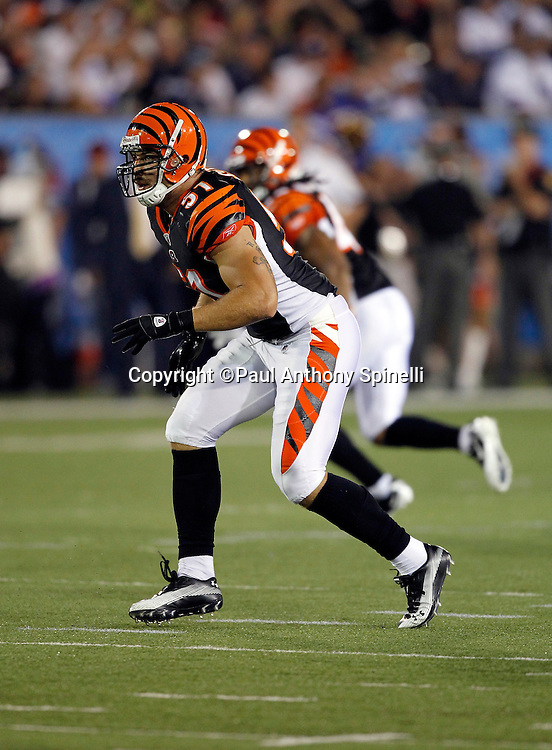Cincinnati Bengals linebacker Dan Skuta (51) chases the play during the NFL Pro Football Hall of Fame preseason football game between the Dallas Cowboys and the Cincinnati Bengals on Sunday, August 8, 2010 in Canton, Ohio. The Cowboys won the game 16-7. (©Paul Anthony Spinelli)
