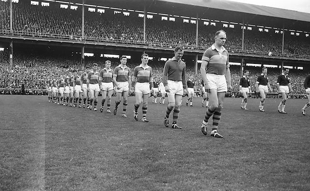Kerry team lines out onto the pitch before the start of the All Ireland Senior Gaelic Football Championship Final, Kerry vs Galway in Croke Park on the 27th September 1964. Galway 0-15 Kerry 0-10.