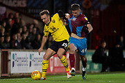 Oxford United defender Anthony McMahon battles for the ball with Scunthorpe United midfielder Ryan Colclough during the EFL Sky Bet League 1 match between Scunthorpe United and Oxford United at Glanford Park, Scunthorpe, England on 3 November 2018.