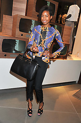 TOLULA ADEYEMI at an invitation-only acoustic performance by Rita Ora hosted by Calvin Klein Jeans at their Regent Street Store, London on 18th February 2013.