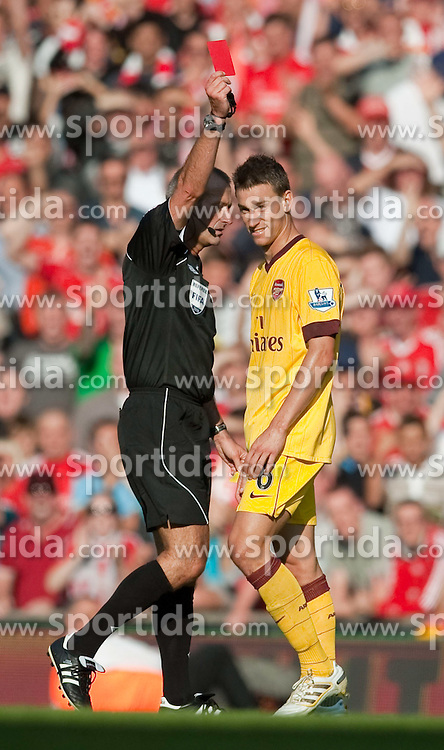 15.08.2010, Anfield, Liverpool, ENG, PL, FC Liverpool vs FC Arsenal, im Bild Arsenal's Laurent Koscieiny is shown the red card by referee Martin Atkinson during the Premiership match against Liverpool at Anfield. l. EXPA Pictures © 2010, PhotoCredit: EXPA/ Propaganda/ David Rawcliffe / SPORTIDA PHOTO AGENCY