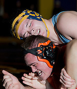 Zack White of Dirigo (top) competes against Sean Cote of Winslow in the championship match for the 220-pound weight class at the Western Maine Regional Wrestling Championships at Bucksport High School on February 2, 2013.