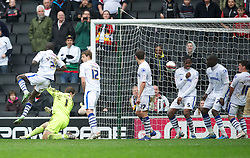 MILTON KEYNES, ENGLAND - Easter Monday, April 9, 2012: The ball hits Tranmere Rovers' Ian Goodison in the face as he stands on the line defending a Milton Keynes Dons free-kick during the Football League One match at the Stadium MK. (Pic by David Rawcliffe/Propaganda)