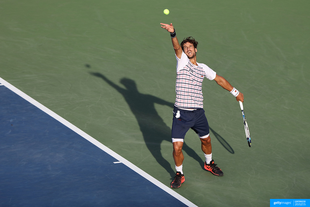 Feliciano Lopez, Spain, in action against Fabio Fognini, Italy, on Louis Armstrong Stadium, during the US Open Tennis Tournament, Flushing, New York, USA. 6th September 2015. Photo Tim Clayton