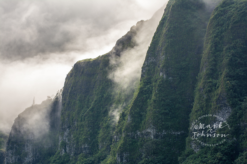 Clouds blanket the vertical cliffs of the Koolau Mountains, Windward Oahu, Hawaii
